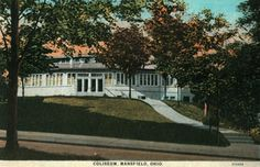 Color tinted photo of the front of the coliseum at North Lake Park in Mansfield, Ohio, showing the sidewalk leading up a small knoll from the street.