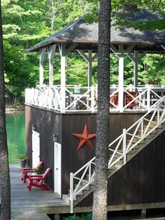 Rooftop Deck - stairs and a rooftop deck added to an existing boathouse, creating more outdoor entertaining space. Tin star from a flea market.    Read more: Home Decorating Ideas - Rustic Decor - Country Living