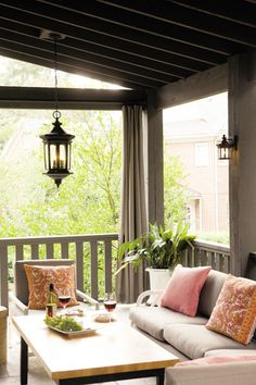 Make your porch a habitable space for guests this winter with some outdoor lighting and space heaters.
