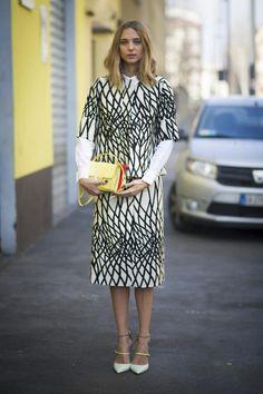 Candela Novembre wearing the Jimmy Choo TYPHOON pump and carrying the Jimmy Choo REBEL bag at Milan Fashion Week