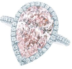 Pink diamond and diamond ring by Tiffany and Co. A pear-shaped 2.11ct fancy intense pink diamond, surrounded by a single row of white diamonds set in platinum. Via Diamonds in the Library.