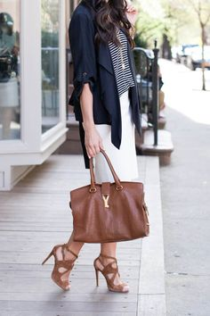 This work outfit is so simple, but it still looks polished. Note how the easy cuts of the tank and jacket play off the more streamlined pencil skirt.