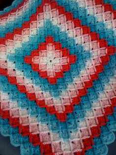 Gorgeous example of the Wooleater Blanket. There is a link to the pattern but if you cant find it here it is- http://sarahlondon.wordpress.com/2009/08/25/wool-eater-instructions/