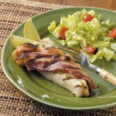 Halibut with Bacon - one of my favorite halibut recipes. Marinated in lime, wrapped in bacon, and grilled. Holy yummy.
