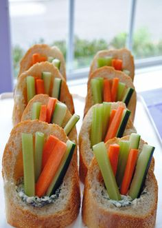 Spinach dip w/ veggies in baguettes. Such a cute appetizer idea.