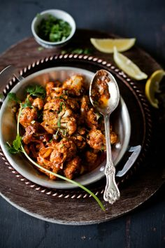 Achari Gobi (Cauliflower In Pickled Sauce)   To make vegan use a vegan yogurt, cashew would be sublime.