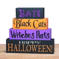 Mini Word Block Halloween Decoration Set of 4 Material: MDF (pressed wood product) Size: 1.50 x 7.00 x 6.50 Word blocks: Bats - Black Cats - Witches Hats - Happy Halloween!