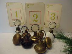 Table Number Holders, Vintage Doorknobs. $8.00, via Etsy.