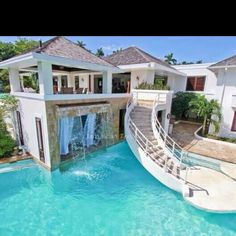 This is my dream house!!! Master bedroom right under that waterfall... Yes please :)