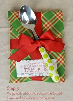 Great way to gift wrap a cookbook in a usable wrapper - kitchen towel & a pretty spoon!