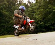 Godwin on his little motorcycle lol