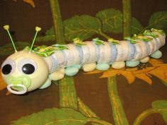 Learn to make a DIAPER CATERPILLAR from diapers and such. GR8 Baby Shower Gift.. $8.99, via Etsy.