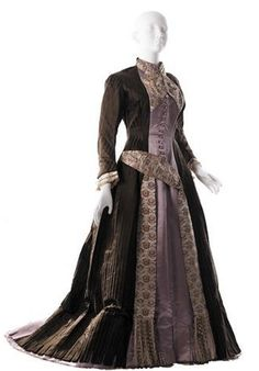 1879 extant visiting dress -looks like Princess seams, very pretty floral fabric on the collar, belt, and down front of dress