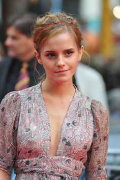 Emma Watsons elegant headband updo hairstyle