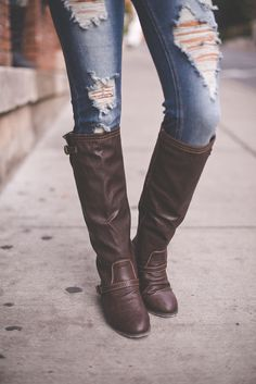 Boots & torn jeans