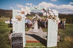 Love the pale blue doors opening to this gorgeous outdoor ceremony!