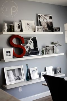 Awesome photo wall with shelves and a monogram. This would be great in my dining room.