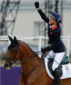 216b: Nothing is quintessentially olympic quite like the cheer of the victor. This overwhelmingly positive image depicts british media darling Zara Phillips. The close cropping only directs the eye to emphasize the point.