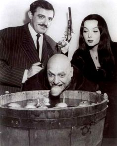 John Astin as Gomez Addams, Carolyn Jones as Morticia Addams and Jackie Coogan as Uncle Fester in The Addams Family tv show