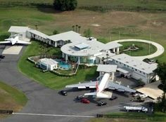 Ocala, FL - John Travolta built this $2.5 million dollar Florida house at the end of a private runway in Ocala, Florida, which includes parking for his Boeing 707 and Gulfstream jets. Oh, and a 16-car garage