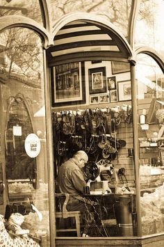 Shoemaker Inside the Glass Window in Harvard Square by Bimal Nepal