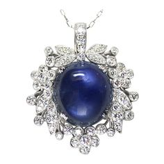 1940's Raymond Yard Star Sapphire Diamond and Platinum Pendant. 1940's Raymond Yard pendant set with a star sapphire weighing 15.83 carats, and 2.75 carats of round diamonds. The pendant is suspended off of a delicate platinum chain set with old miner diamonds. Signed 'Yard'.