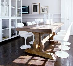 love the juxtaposition of rustic, antique table with modern, clean lined chairs