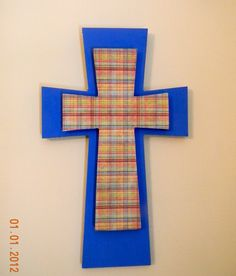 Got 2 wooden, unfinished crosses at Hobby Lobby (on sale!).  Painted the bigger cross first, along with the edges of the smaller cross.  Put some modge podge on the smaller cross & covered with scrapbook paper!