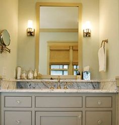 Designed by Erika Powell. Grey cabinets with marble counter top.
