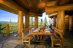 Massive cedar post-and-beam plus over-sized flagstone patio. Pioneer Log Homes of British Columbia