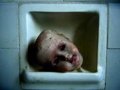 Doll head in the bathroom.