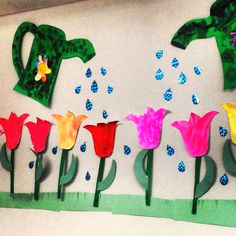 """Spring has sprung"" wall art. Have each preschooler paint a tulip, and decorate a few big watering cans. Make some sparkly water drops and presto! Springtime!"