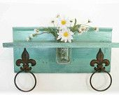 Cool little shelf with towel rings and a fabulous compartment for a mason jar to display fresh cut flowers.