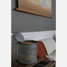Fabulous idea. Minnow bucket with candle in it.....great idea for the cabin on the lake or room with mounted fish!