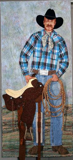 """Buck A. Roux"" by Charlotte Freeman.  1st place innovative quilt, 2004 Road to California. Original design; dye painting, fabric manipulation and collage style applique.  The hat, saddle and rope are 3 dimensional."