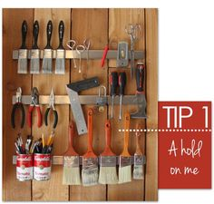 Ten awesome tips for organizing a painting studio: Magnetic racks for storing paint and stencil brushes