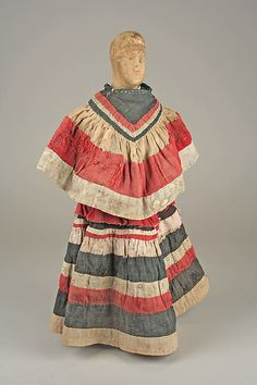 Early 20th century Seminole doll. Wood with cotton and beads.