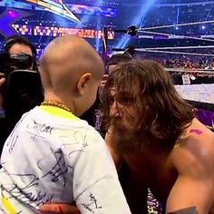 "Connor was at ringside, with his father, and was the first person Daniel Bryan embraced after his win. | WWE's Tribute To 8-Year-Old Connor ""The Crusher"" Michalek Will Bring You To Tears  This made me cry"