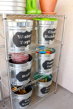 Such a cute and inexpensive idea to organize all those outdoor items. The kids can grab a bucket and go play! Did you know that you can buy chalkboard contact paper? Switch out those bucket labels quickly and easily. Alternatively, simply use Post-it Note Labels. Happy Summer!