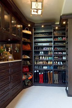 Hang necklaces on hooks on side of vanity in closet  Master Closet shoe and boot storage