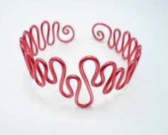 Adjustable bracelet in wire wrapped red aluminium (Wire wrapping aluminum). $17.00, via Etsy.