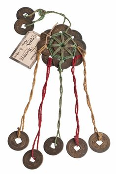 Magickal Ritual Sacred Tools:  Talisman to protect against poverty, comprising several coins bound together into a circle, with five coins suspended beneath and two above.