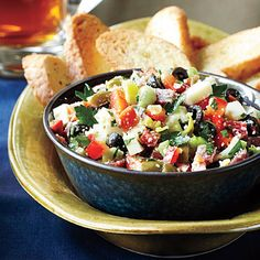 Muffuletta Dip | You can serve this versatile recipe on French bread crostini or with crackers over a block of cream cheese. Try tossing leftovers in a Caesar salad.