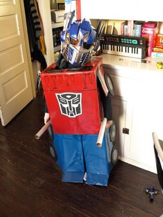 Homemade transformer costume.  You can pull in your arms and legs and lay down under in and it becomes the truck!  It's the 3rd Annual Modern Kiddo Costume Parade! {Cool Homemade Costumes!} – Modern Kiddo