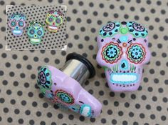This persons etsy shop looks awesome. Haven't bought anything yet, but I'm about to! I love all the gauges! In the pic: Sugar skull tunnels plugs for gauged or stretched ears: 4g (5mm),2g (6mm), 0g (8mm), 00g (10mm), 7/16 (11mm), 1/2 (12mm) via Etsy