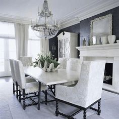 Love the dark paint offset with white furniture and accents in this dining room.
