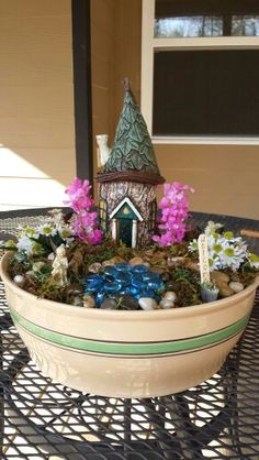 """Pinner says, """"Tabletop Fairy Garden created by my niece. The house and fairies came from @Hobby Parent : Artist-Coach Parent : Artist-Coach Parent : Artist-Coach Parent : Artist-Coach Parent : Artist-Coach Parent : Artist-Coach Lobby"""""""