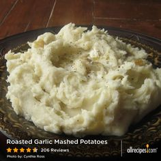 "Roasted Garlic Mashed Potatoes | ""I made these for Thanksgiving this year and they were a big hit. I also made a vegan version with vegan butter and soy milk- which were also surprisingly delicious."""