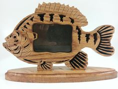 Unique and fun picture frame cut using a scrollsaw    https://www.etsy.com/listing/160450501/fretwork-panfish-picture-frame?ref=shop_home_active