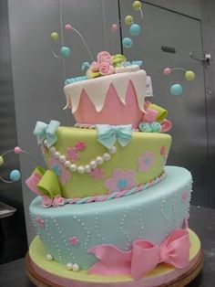 Love topsy-turvy cakes. - This would be a cute baby shower cake.